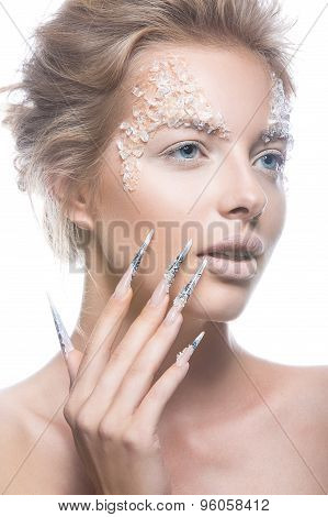Beautiful fashion model with long nails, creative makeup and manicure design. Beauty face art.