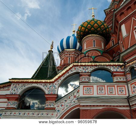 Detail of St. Basil's Cathedral with cloudy sky reflecting in windows