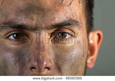 Closeup hispanic man dirty face eyes and nose caption looking to camera