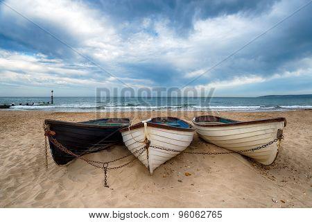 Boats On A Sandy Beach