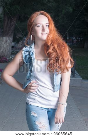 Young red-haired women outdoors .