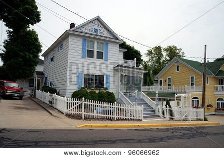 Cottage with White Picket Fence