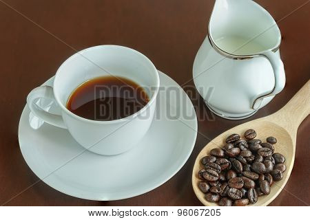 Fresh Coffee Cup And Coffee Bean On The Table