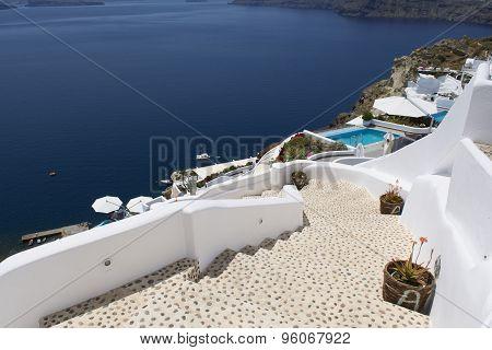 Stairs leading down to Aegan Sea. Oia, Santorini, Greece.