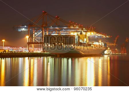Container Cranes In Hamburgs Harbour, Ship Offloading