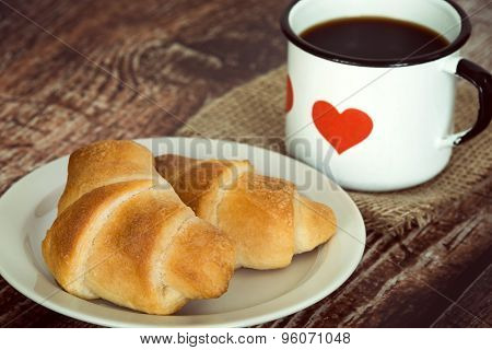Breakfast Croissants And Coffee On Vintage Rustic Background