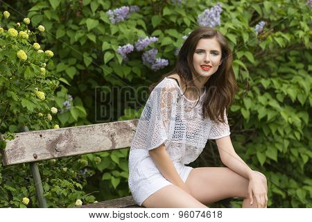 Casual Woman In Luxuriant Garden