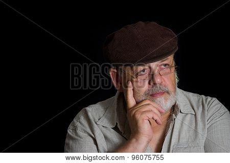 Portrait of senior man in cap