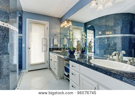 Extraordinarily Beautiful Bathroom With Deep Blue Tile Walls And Counter, Along With White Accents.