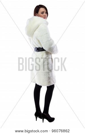 Photo of woman in white fur coat with hood