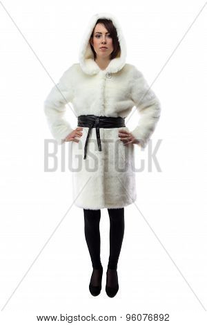 Image of woman in white fur coat with hood