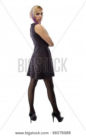 Woman in artificial suede dress, full length