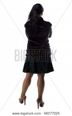 Photo of pudgy woman in fur jacket, from back