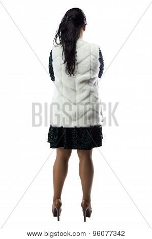 Image pudgy woman in white fur jacket, from back