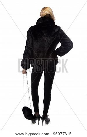 Photo of woman with fur bag, from back