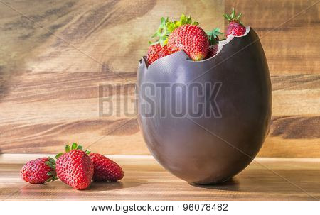 Chocolate Easter Egg With The Top Broken Off Filled With Strawberry