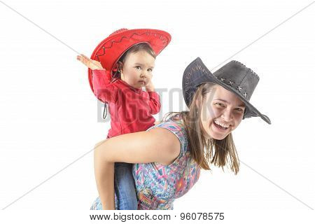 Two Girls Piggybacking Isolated On White