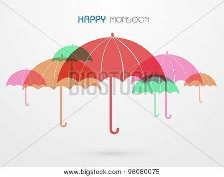 Colorful umbrella on grey background for Happy Monsoon.