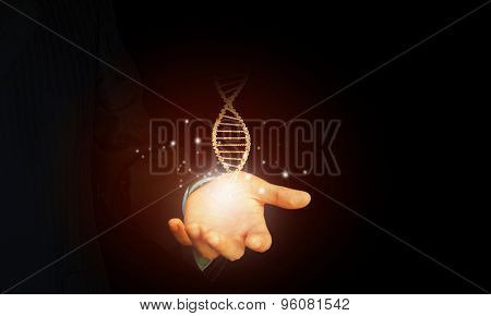 Close up of man holding DNA molecule in palm