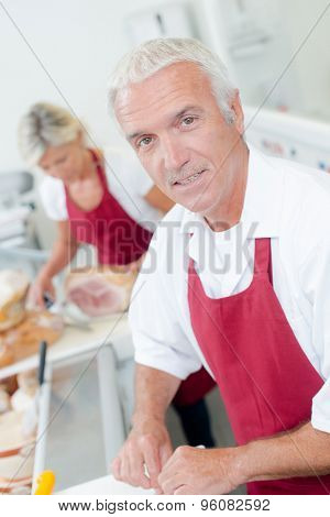 Butcher serving a female customer