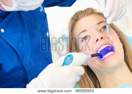 Checking inside woman's mouth