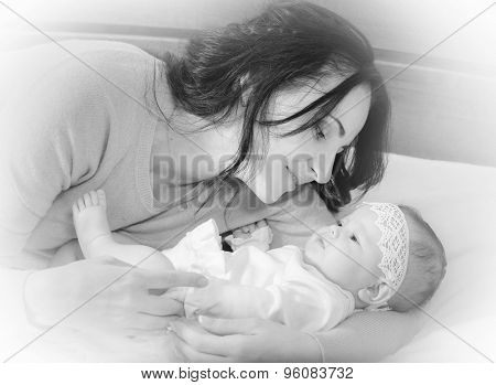 mother and her newborn baby, maternity concept, soft image of beautiful family