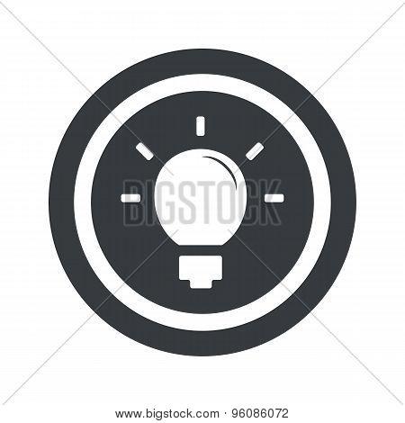 Round black light bulb sign