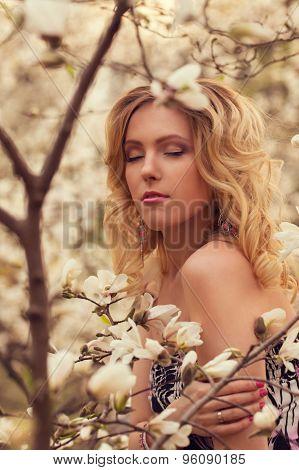 Beauty Smiling Woman Near White Magnolia