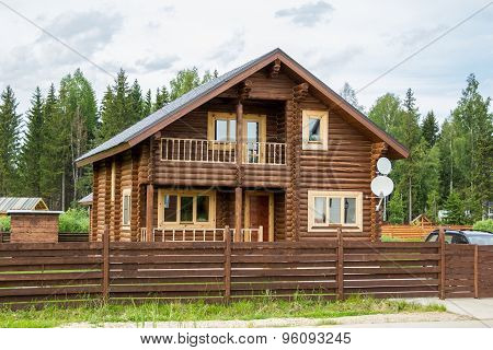 Brown Wooden House Behind Wooden Fence