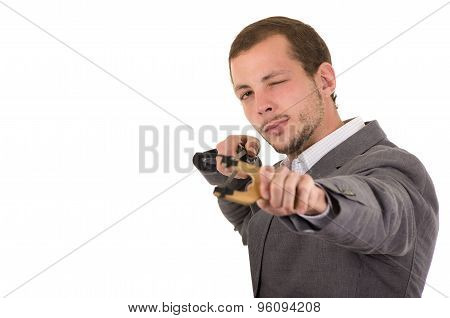 Hansome buisness man concentrated aiming a slingshot isolated over white background