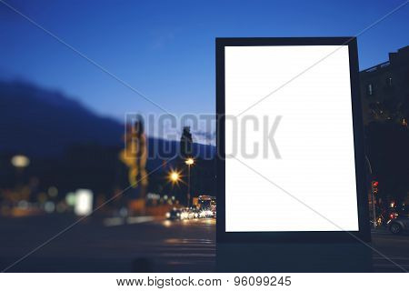Advertising mock up banner in metropolitan city with beautiful dusk on background