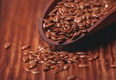 pic of flax seed oil  - The flax seeds in a wooden bowl close up  - JPG