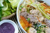 stock photo of scallion  - Vietnamese food bun rieu a famous dish of Vietnam raw material as tomato crab pork meat shrimp salad scallion egg vegetable shrimp paste bunrieu is Viet Nam special eating - JPG