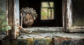 Постер, плакат: Chernobyl Doll Looks Out A Window