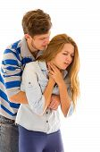 stock photo of choke  - Couple demonstrating first aid techniques by man performing heimlich on female choking - JPG