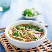 stock photo of cilantro  - traditional pho tai beef vietnamese soup in bowl with cilantro and bean sprouts - JPG