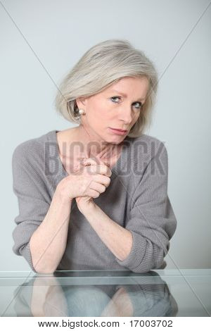 Senior woman with unconcerned expression