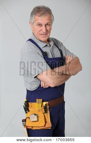 Portrait of senior artisan on white background