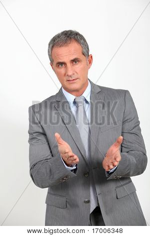 Businessman presenting project looking at camera