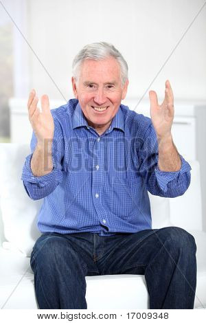 Portrait of elderly man showing positivity