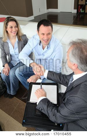 Couple shaking hand to real-estate agent