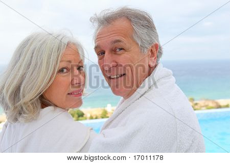 Portrait of happy senior couple in spa center
