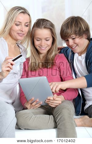 Mother and children doing online shopping