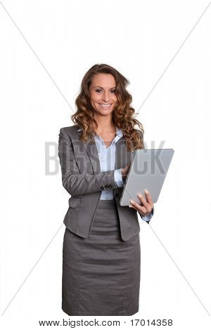 Businesswoman standing on white background with electronic tablet