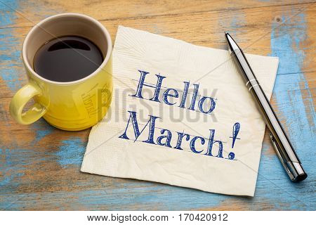 Hello March - handwriting on a napkin with a cup of coffee
