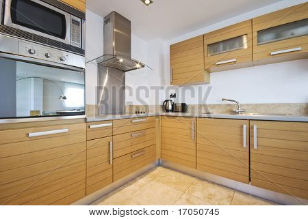 fully fitted modern kitchen in birch wood finish with modern appliances