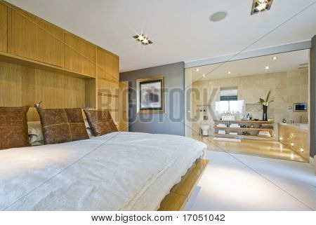 large luxury penthouse bedroom with en suite bathroom
