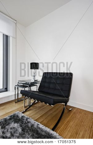 contemporary designer armchair on chrome frome and leather cushions