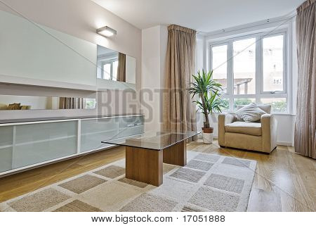contemporary furnished living room with bay window