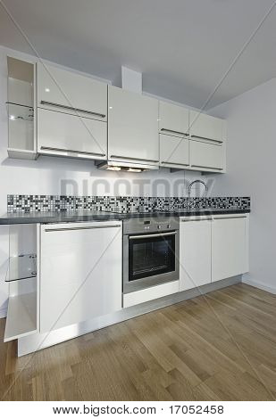 luxury modern kitchen in white with mosaic tiles